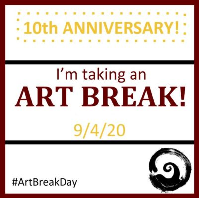 take an art break placard to show support for Art Break Day and Art is Moving