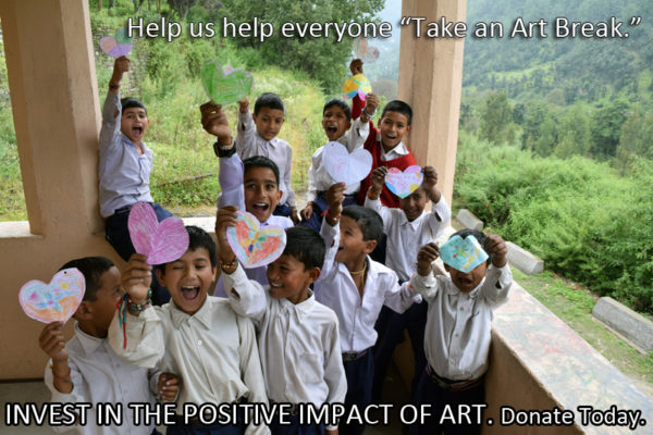 A group of kid's celebrate after receiving an opportunity to take an art break.